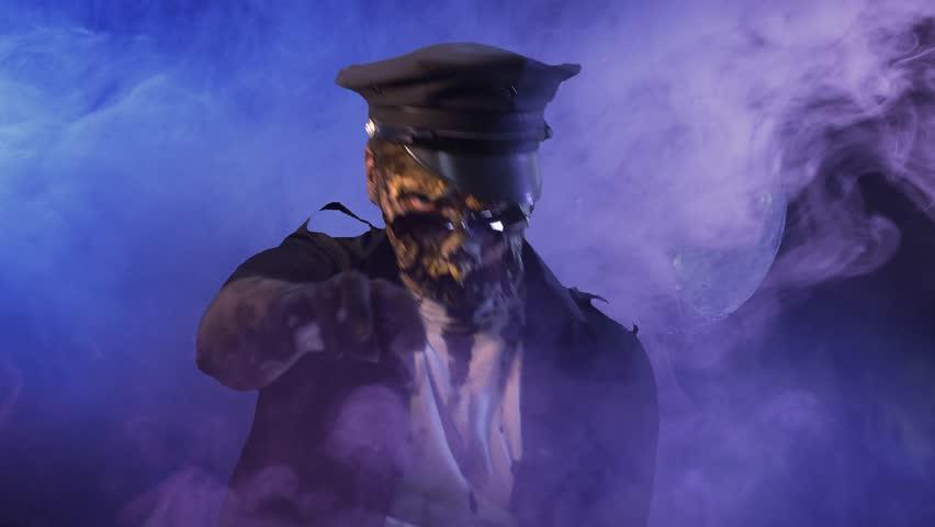 Scary zombie COP on dark background in Halloween makeup | Shutterstock HD Video #1011440093