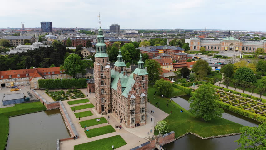 Aerial view of Rosenborg Castle (renaissance style palace) situated in The King's Garden (Kongens Have) - central Copenhagen, capital city of Denmark from above | Shutterstock HD Video #1011516233
