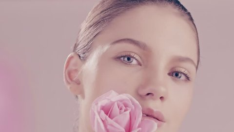 Beautiful young model with roses beauty skincare concept