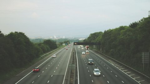 Out of focus slow traffic on M5 Motorway C, Captured in Clapton-in-Gordano, England - split toning