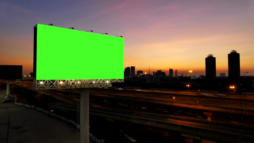 4K of Advertising billboard, green screen, at sunset near expressway. time lapse.