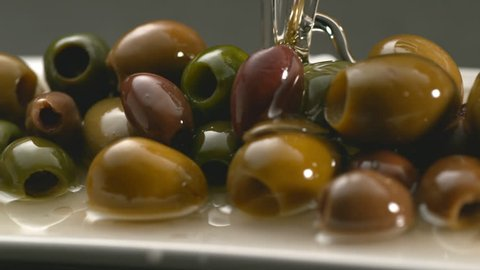 Olives and olive oil in slow motion