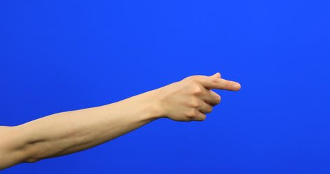 Male fingers grabbing and pulling something invisible toward him on blue screen