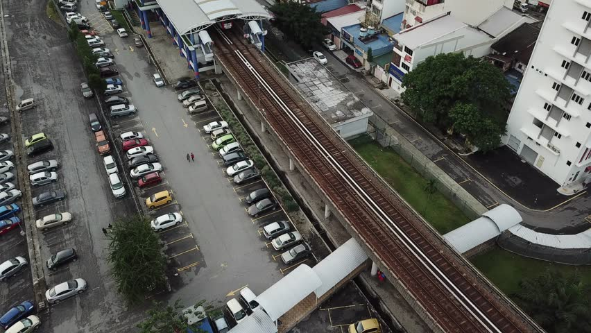 Kuala Lumpur, Malaysia - May 30, 2018 : Aerial view of LRT Station at Jalan Pasar Pudu during afternoon. This clip footage was capture thru drone. | Shutterstock HD Video #1011685523