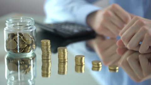 Man counting coins, increase of income, financial pyramid concept, investment
