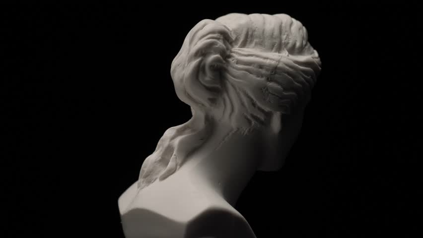 Ancient roman era white marble statue of Venus rotating and showing every angles. Closeup shot with black background. | Shutterstock HD Video #1011693353