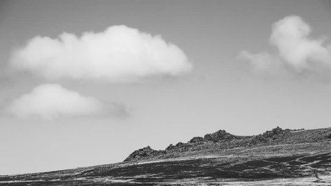 Fluffy clouds over Carn Menyn Rocks on Preseli Hills Pembrokeshire Black and White Timelapse