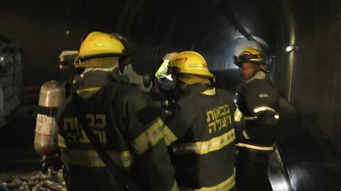 Firefighters get instructions from their commander using words and hands  during a drill in ixal tunnels  nazareth, israel, may 06, 2018