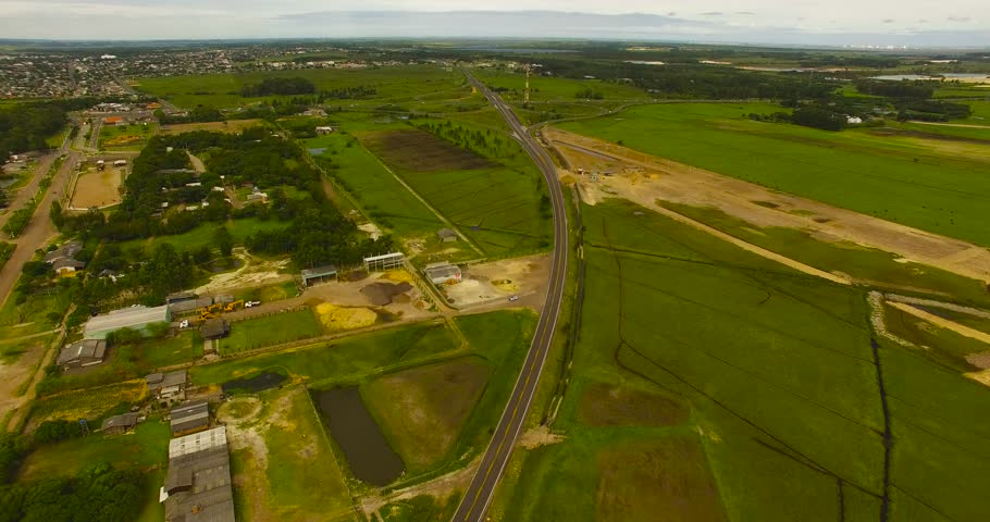 Rio Grande do Sul, Brazil 2018: Aerial footage of Brazil in Rio Grande do Sul agriculture along highway.Drone footage of a wind farm located in southern Brazil. Overlooking the wind turbine farm with