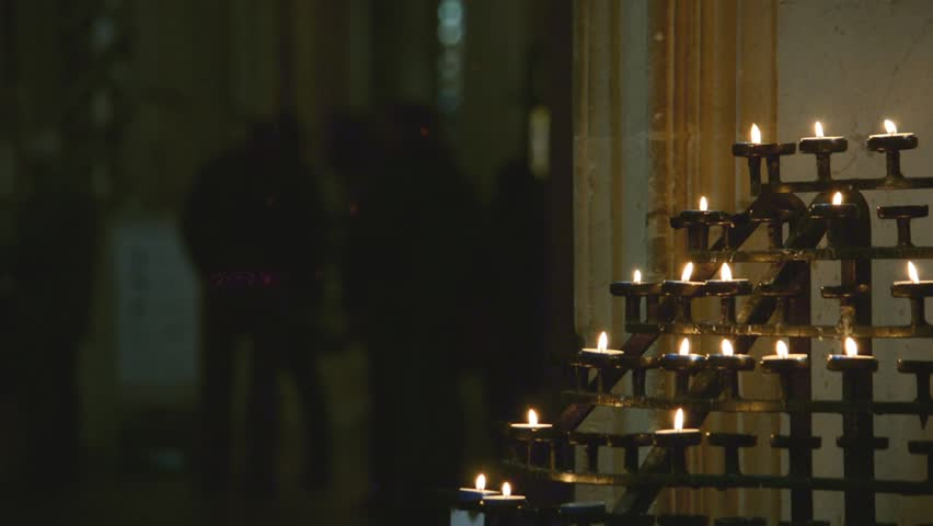 Church Prayer Candle Holders, walking people in background, religious building, shallow depth of field