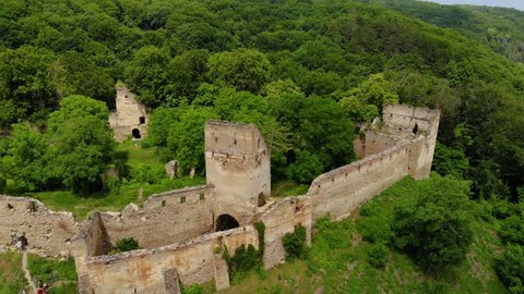 Aerial video of Saschiz medieval fortress. Fortress from above. Aerial footage from a drone. Transylvania. Romania. Medieval Architecture in Carpathia. Tree in the tower. Abandoned citadel