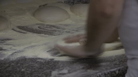 Stretching pizza dough with hands