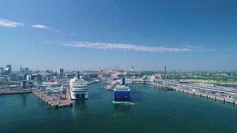 The cruise ship arrives at the harbour on a summer sunny day. Estonia. Tallinn.