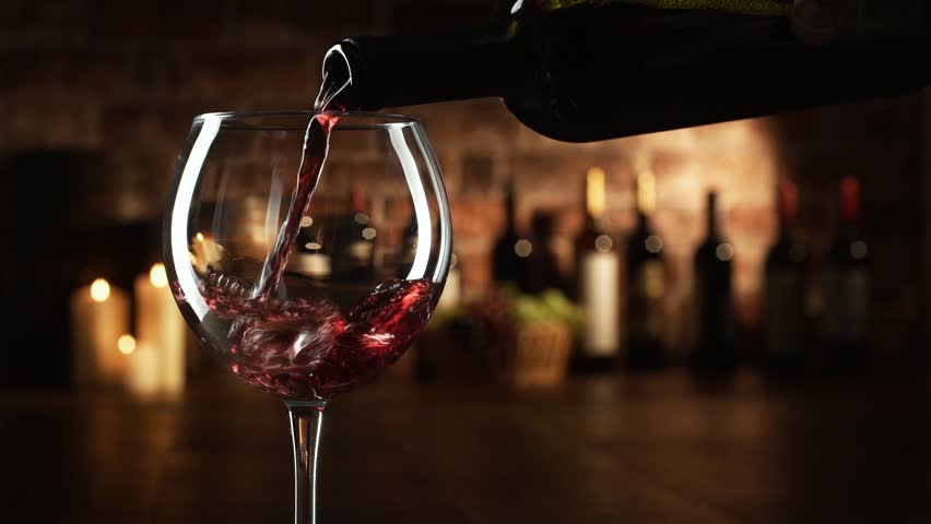 Sommelier tasting wine in the cellar, he is pouring an excellent red wine in a glass | Shutterstock HD Video #1011844853