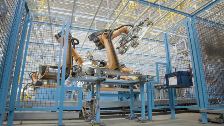 Industrial setup. Slow motion shot car factory production line. Car engine robot | Shutterstock HD Video #1011879443