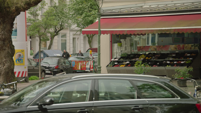 City street corner with fruit stand. May, 2017 Berlin, Germany | Shutterstock HD Video #1011886613