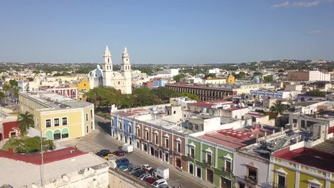 Wide Angle Drone Shot of Campeche, Mexico in the Yucatan Peninsula During a Sunny Summer Day. Colorful Buildings and Roofs are Present Throughout the Shot.