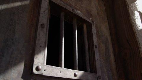 Old west jail door in prison building