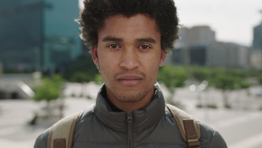 Portrait of handsome young mixed race man unhappy worried looking at camera sad in urban city  | Shutterstock HD Video #1011926093