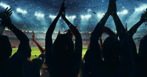 Fans clapping hands to cheer their favorite sports team on the stands of the professional stadium while it's snowing. Stadium is made in 3D and animated.