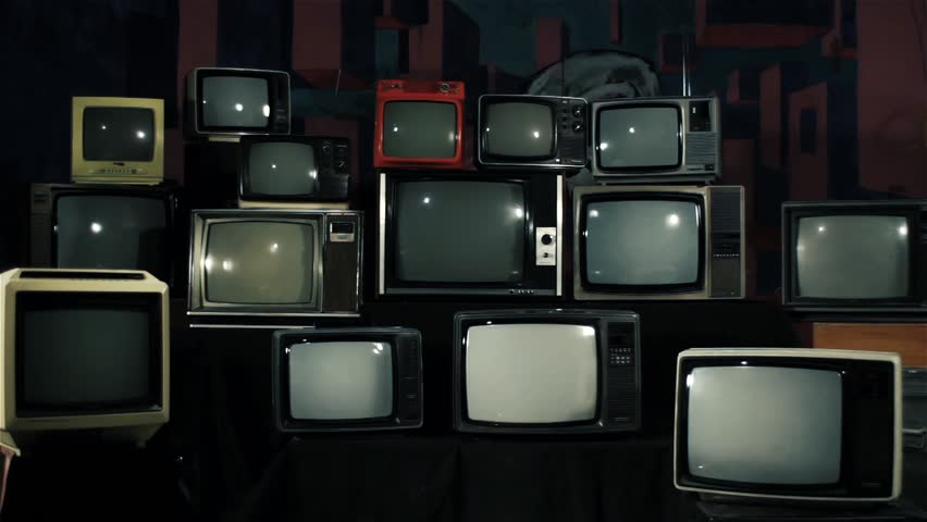 Many Tvs with Green Screens Turning On. Iron Tone. Aesthetics of the 80s. Ready to Replace Green Screens with Any Footage or Picture you Want.  | Shutterstock HD Video #1012060613