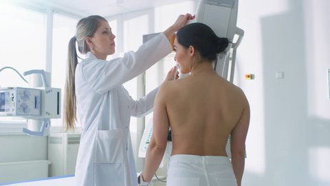 In the Hospital, Female Patients Undergoes Mammogram Screening Procedure Done by Mammography Technologist. Modern Technologically Advanced Clinic with Professional Doctors.  Shot on RED EPIC-W 8K.