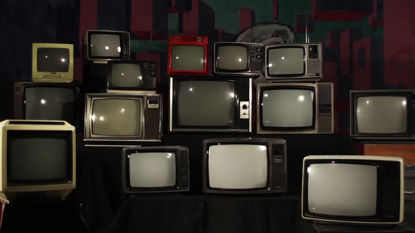 Many Tvs with Green Screens Turning On. Zoom In. Aesthetics of the 80s. Ready to Replace Green Screens with Any Footage or Picture you Want.    Shutterstock HD Video #1012061723