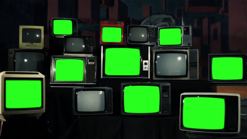 Many Tvs with Green Screens Turning Off. Iron Tone. Zoom In. Aesthetics of the 80s. Ready to Replace Green Screens with Any Footage or Picture you Want.  | Shutterstock HD Video #1012061993