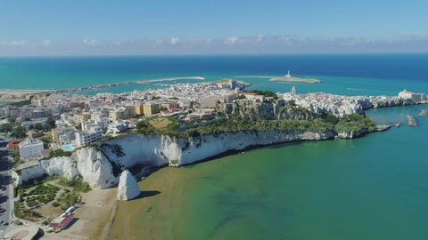 White rock and beach Polignano a Mare Apulia City Sea Coastline white houses and castle in Italy Drone flight