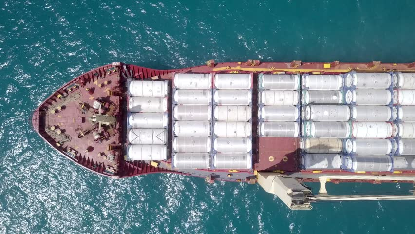 Large general cargo ship loaded with gas containers - Top down aerial footage #1012107563