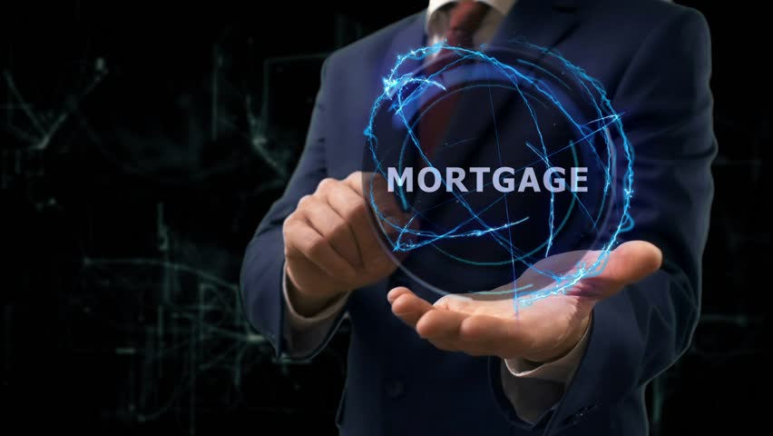 Businessman shows concept hologram Mortgage on his hand. Man in business suit with future technology screen and modern cosmic background