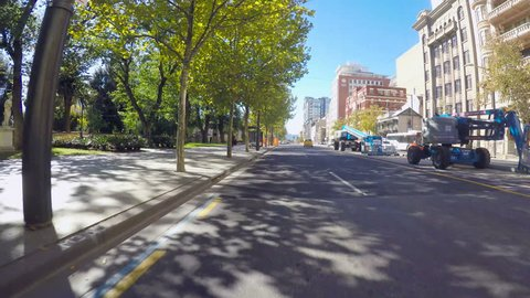 Adelaide, South Australia - April 29, 2018: Action camera vehicle POV driving along North Terrace past the State Library and Museum.