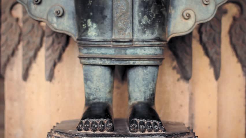 Wat Ho Phra Keo Temple, Vientiane, Laos. Feet of mythical Garuda eagle. Statue at the main entrance door.