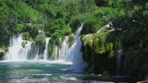 Krka National Park Croatia Europe, Beautiful nature and landscape video with sound, Nice outdoors with flowing water from rivers, lakes and waterfalls.