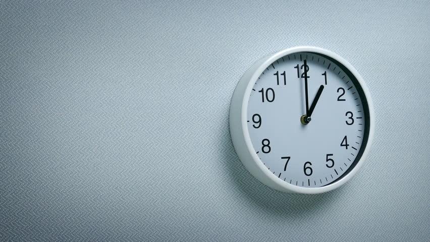 1 O'Clock - Wall Clock Moving Shot   Shutterstock HD Video #1012191533