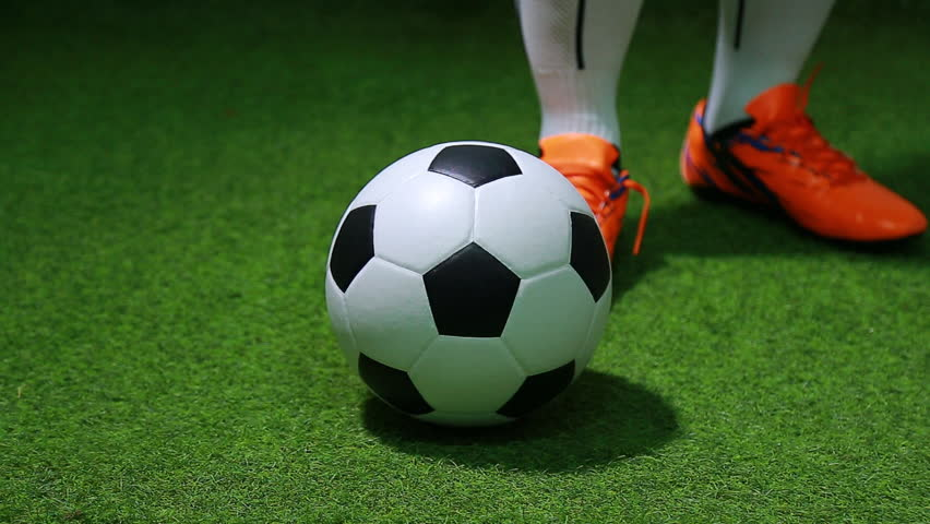 Close up legs and feet of soccer player or football player walk on green grass ready to play match. #1012197233