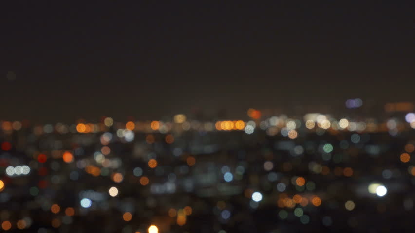 Bokeh of city lights, Blurry photo at night time. 4K cityscape VDO