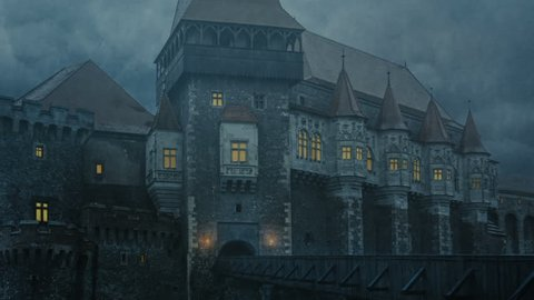 Corvin Castle in Transylvania on a stormy night - facade