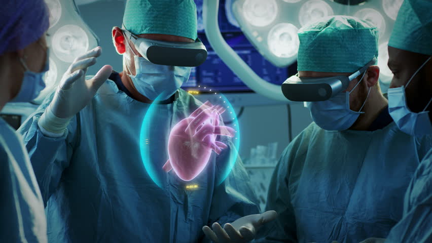 Surgeons Perform Heart Surgery Using Augmented Reality Technology. Difficult Heart Transplant Operation Using 3D Animation and Gestures. Interactive Animation Shows Vital Signs. Futuristic Hospital. | Shutterstock HD Video #1012263473