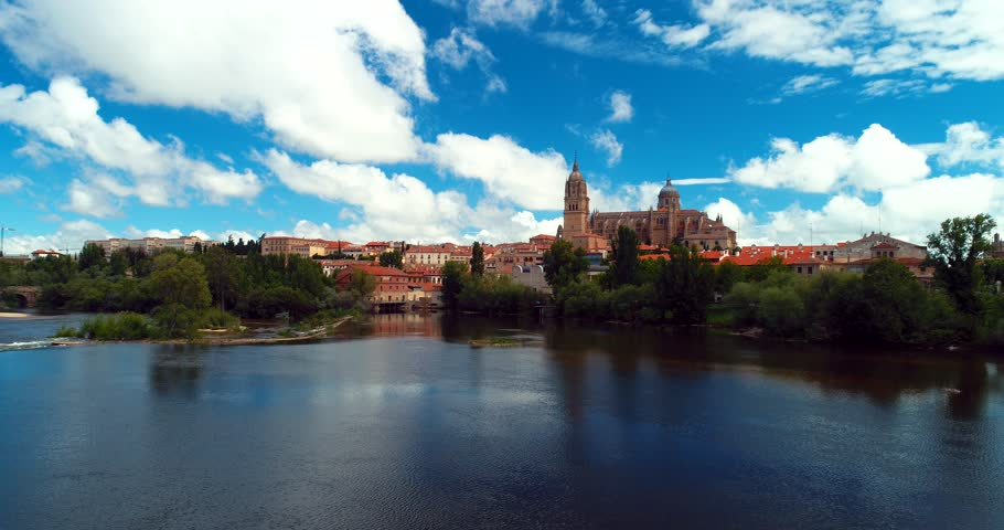 Above the Tormes River in Salamanca . Aerial 4k with the New Cathedral in Salamanca, a city in northwestern Spain that is the capital of the Province of Salamanca in the community of Castile and León.