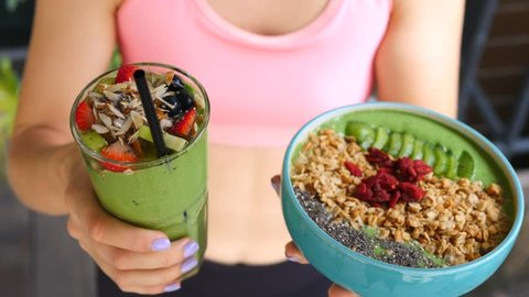 Healthy Lifestyle. Vegan Breakfast With Green Smoothie And Granola With Superfoods