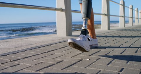 Disabled woman walking near beach on a sunny day 4k