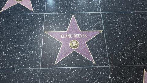 Hollywood, CA, USA - 05/03/18: Hollywood Walk of Fame Star with Keanu Reeve's name. Wide and CU Detail. For editorial purposes. Must get approval for 'commercial' use