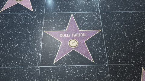 Hollywood, CA, USA - 05/03/18: Hollywood Walk of Fame Star with Dolly Parton's name. Wide and CU Detail. For editorial purposes. Must get approval for 'commercial' use
