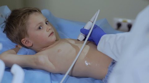 Doctor check heart of little boy with ultrasound equipment