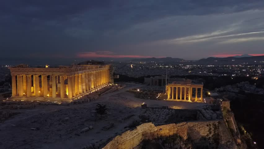 Athens Acropolis, Parthenon and  temple of Erechtheio. Captured in 4k aerial drone view from above at sunset