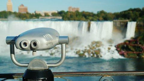 With a coin operated binoculars overlooking the Niagara Falls