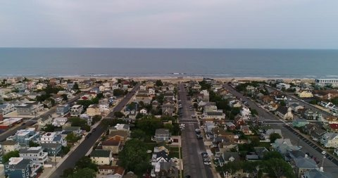 Beautiful 4K slow motion aerial of the town of Beach Haven, New Jersey, flying out towards the town