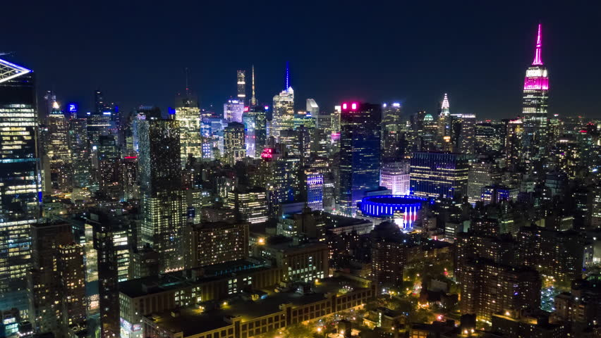 Aerial night view of Manhattan, New York City. Tall buildings. Timelapse dronelapse. NY from above. | Shutterstock HD Video #1012402223