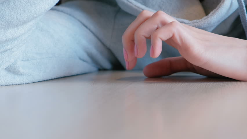 Closeup woman's hand nervously knocking fingers on the table. | Shutterstock HD Video #1012419053
